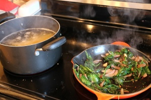 cooking the veggies and noodles